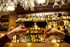 Ladies is bar. With red wine Stock Photo