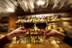 Ladies is bar. With red wine Stock Photography