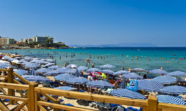 Ladies Beach - Kusadasi. Ladies Beach is one of the most popular and busiest beaches in Kusadasi, Turkey. The name derived from the time when the beach was Stock Photography