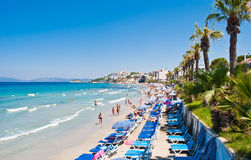 Ladies Beach, Kusadasi, Turkey. Ladies Beach, known in Turkish as Kadinlar Denizi, is one of the most popular and busiest beaches in Kusadasi. The name derived Royalty Free Stock Image