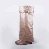 Ladies beige boots Royalty Free Stock Photography