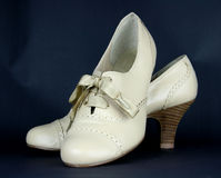 Ladies beige leather high heeled shoes Stock Photography