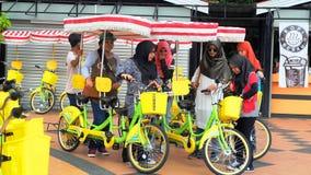 Ladies and big bicycle Royalty Free Stock Image