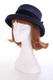 Ladies blue hat. A blue ladies hat on a white manequin isolated on white Royalty Free Stock Image