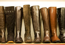 Ladies boots at shop Stock Photos