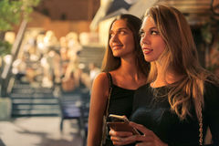 Ladies in the city. At night Royalty Free Stock Photography