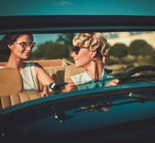 Ladies in a classic convertible Stock Images