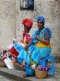 CUBAN LADIES IN TRADITIONAL COLORFUL DRESSES, HAVANA, CUBA. Havana, Cuba - January 19, 2016: Two cuban ladies dressed in traditional colorful dresses in a street Stock Images