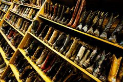 Ladies' cowboy boots line the shelves, Austin, TX stock image