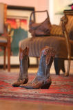 Ladies cowboy boots sitting on a red carpet Stock Image