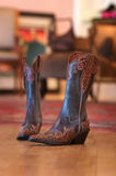 Ladies cowboy boots sitting on a wood floor. A pair of ladies cowboy boots sitting on a wood floor royalty free stock photography