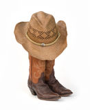 Ladies Cowboy Boots with Straw Hat. Ladies Cowboy Boots with Rumpled Straw Hat Stock Images