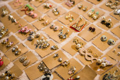 Ladies earrings for sale on market Royalty Free Stock Photography