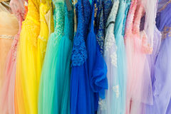 Ladies evening dresses of different colors at shop Royalty Free Stock Photography