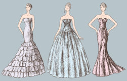 Ladies in evening dresses Royalty Free Stock Images