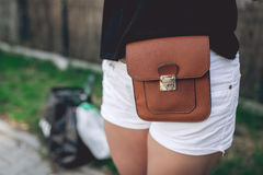 Ladies fancy brown leather bag. Strapped to the hips Royalty Free Stock Photo