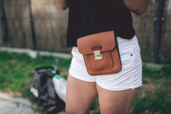 Ladies fancy brown leather bag. Strapped to the hips Stock Image