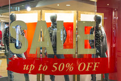 Ladies Fashion Sale. Sale sign of a ladies fashion with displayed mannequin Royalty Free Stock Photos