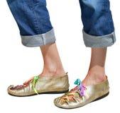 Ladies fun gold shoes Stock Photo