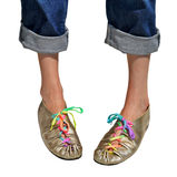 Ladies fun gold shoes Royalty Free Stock Image