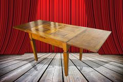 Ladies and gentlemen here is to you the old furniture just restored! - concept image with an old italian furniture on stage.  stock images