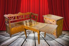 Ladies and gentlemen here is to you the old furniture just restored! - concept image with an old italian furniture on stage.  royalty free stock image