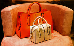 Ladies genuine leather handbags. Pair of ladies genuine leather handbags for sale Stock Photo