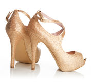 Ladies gold shoes Royalty Free Stock Photography