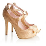 Ladies gold shoes Stock Photos