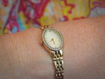Ladies gold wristwatch jewellery timepiece stock photography
