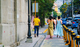 Ladies in gowns walking on the street royalty free stock photos