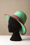 Ladies green fashion hat on display. On a black hat block Royalty Free Stock Photo