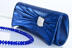 Ladies' handbag and beads Royalty Free Stock Images