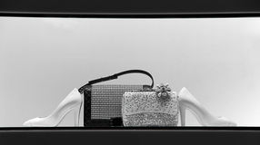 Ladies handbags and shoes. Elegant pairs of ladies shoes and handbags on display Royalty Free Stock Photos