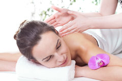 Ladies hands massaging woman Stock Images