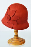 Ladies ' hat. Womens red hat worn on the stand isolated on a light background Royalty Free Stock Images