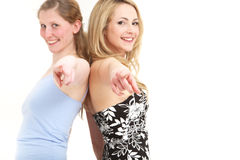 Ladies having fun pointing to camera Royalty Free Stock Photography