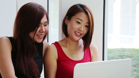 Ladies with laptop Royalty Free Stock Photography