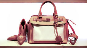 Ladies leather hand bag and shoes. Collection of elegant ladies leather hand bag and trendy pair of shoes on display for sale Stock Photos