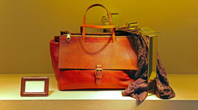 Ladies leather handbag and scarf Royalty Free Stock Images