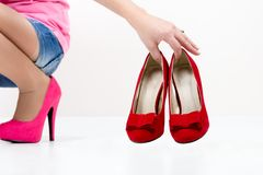 Ladies leg , shoes , and shopping bag Stock Photos