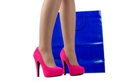 Ladies leg , shoes , and shopping bag Royalty Free Stock Photo