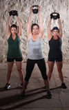 Ladies Lifting Weights in Boot Camp Workout stock photo