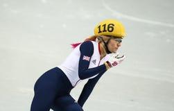 Ladies' 1000 m Heats Short Track Heats. Sochi, RUSSIA - February 18, 2014: Elise CHRISTIE (GBR) No.116 at Ladies' 1000 m Short Track Heats at the Sochi 2014 Stock Images