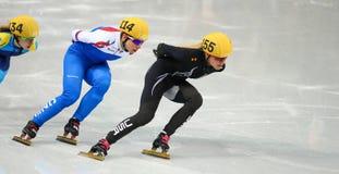 Ladies' 1000 m Heats Short Track Heats. Sochi, RUSSIA - February 18, 2014: Emily SCOTT (USA) No.155 at Ladies' 1000 m Short Track Heats at the Sochi 2014 Olympic Royalty Free Stock Photos