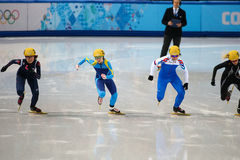 Ladies' 1000 m Heats Short Track Heats. Sochi, RUSSIA - February 18, 2014: Inna SIMONOVA (KAZ) No.134 at Ladies' 1000 m Short Track Heats at the Sochi 2014 Royalty Free Stock Image