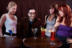 Ladies' Man. Happy men during ladies night at a bar Royalty Free Stock Photos