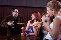 Ladies' Man. Happy men during ladies night at a bar Royalty Free Stock Photo