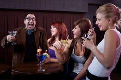 Ladies' Man. Happy men during ladies night at a bar Stock Photo