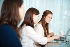 Ladies meetings. Business meeting between ladies with a laptop on the table royalty free stock image